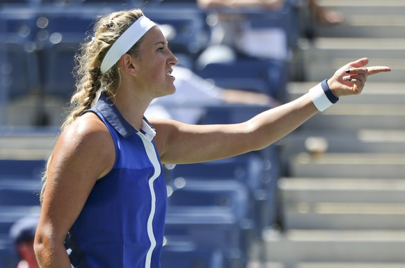 Victoria Azarenka, of Belarus, motions to the chair umpire after a shot against Ekaterina Makarova, of Russia, during the quarterfinals of the 2014 U.S. Open tennis tournament, Wednesday, Sept. 3, 2014, in New York. (AP Photo/Mike Groll)