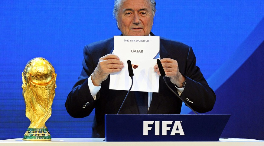 A file picture dated 02 December 2010 of FIFA President Joseph Blatter announcing that Qatar will be hosting the 2022 Soccer World Cup during the FIFA 2018 and 2022 World Cup Bid Announcement in Zurich, Switzerland. FIFA judge Hans-Joachim Eckert has cleared Qatar and Russia of corruption in their successful World Cup bids, football's ruling body said on 13 November 2014. Eckert formally closed the investigation into the bid process but individual cases around the bid process FIFA vote in December 2010 should be prosecuted. FIFA President Joseph Blatter was also cleared from wrongdoings.  (KEYSTONE/WALTER BIERI)