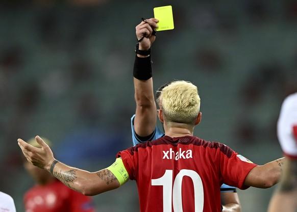 Switzerland's Granit Xhaka gets shown the yellow card during the Euro 2020 soccer championship group A match between Switzerland and Turkey at the Baku Olympic Stadium in Baku, Azerbaijan, Sunday, June 20, 2021. (Ozan Kose/Pool via AP)