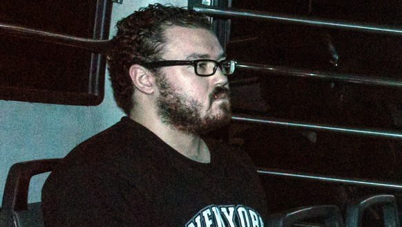 epa05621848 (FILE) A file picture dated 24 November 2014 shows former British banker Rurik George Caton Jutting leaving the Eastern Magistrates Court in a prison van, at Sai Wan Ho, Hong Kong, China. Jutting, 31, has been found guilty of murder of two Indonesian women in 2014 by a jury on 08 November 2016, according to media reports.  EPA/JEROME FAVRE ATTENTION EDITORS : IMAGE ADJUSTED FOR QUALITY