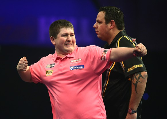 LONDON, ENGLAND - DECEMBER 28:  Keegan Brown of England celebrates winning a leg during his second round match against Adrian Lewis of England on Day Eight of the William Hill PDC World Darts Championships at Alexandra Palace on December 28, 2014 in London, England.  (Photo by Jordan Mansfield/Getty Images)