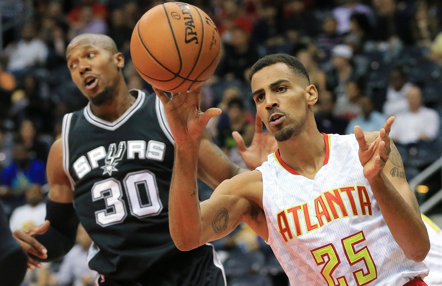 Atlanta Hawks guard Thabo Sefolosha (25) rebounds against San Antonio Spurs forward David West during the first first half of an NBA preseason basketball game Wednesday, Oct. 14, 2015, in Atlanta. (Curtis Compton/Atlanta Journal-Constitution via AP)  MARIETTA DAILY OUT; GWINNETT DAILY POST OUT; LOCAL TELEVISION OUT; WXIA-TV OUT; WGCL-TV OUT; MANDATORY CREDIT