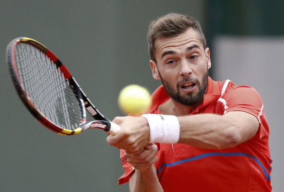 Benoit Paire of France hits a return to Roberto Bautista Agut of Spain during their men's singles match at the French Open tennis tournament at the Roland Garros stadium in Paris May 28, 2014.   REUTERS/Vincent Kessler (FRANCE  - Tags: SPORT TENNIS)