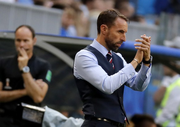 epa06871237 England's manager Gareth Southgate reacts during the FIFA World Cup 2018 quarter final soccer match between Sweden and England in Samara, Russia, 07 July 2018.