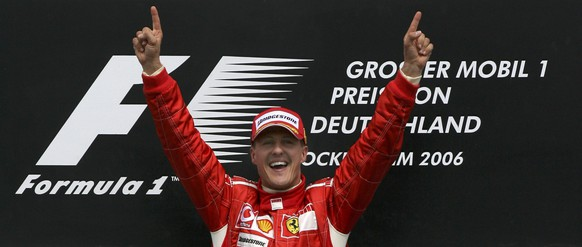 Ferrari driver Michael Schumacher of Germany celebrates after winning the German Grand Prix in Hockenheim, in this July 30, 2006 file picture. Formula One supremo Bernie Ecclestone is keeping the door ajar for German Grand Prix organisers even if this year's race looks doomed.   REUTERS/Ruben Sprich/Files (GERMANY  - Tags: SPORT MOTORSPORT)