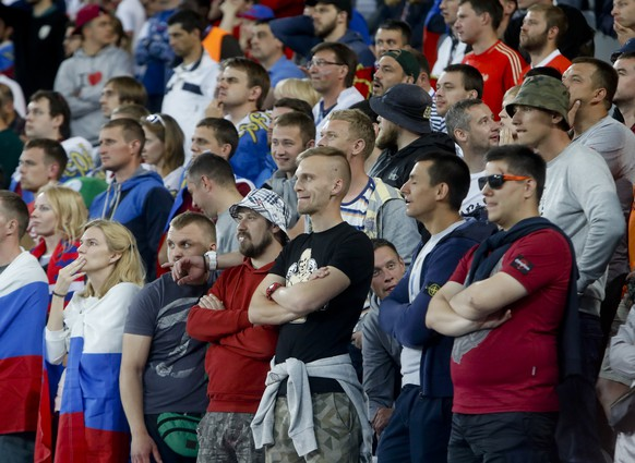 Russian supporters watch the Euro 2016 Group B soccer match between Russia and Slovakia at the Pierre Mauroy stadium in Villeneuve d'Ascq, near Lille, France, Wednesday, June 15, 2016. (AP Photo/Michel Spingler)