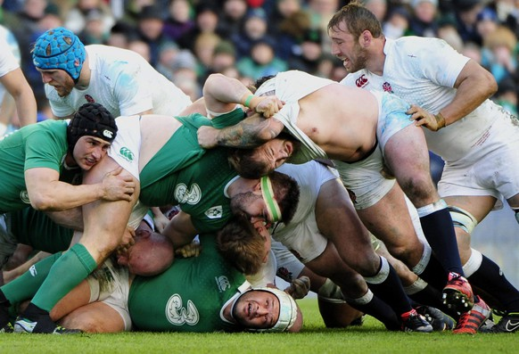 epa04643559 Ireland's Rory Best caught at the bottom of a ruck during the Six Nations Rugby match between Ireland and England in The Aviva Stadium, Dublin, Ireland, 01 March 2015.  EPA/Aidan Crawley