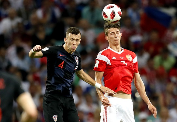epa06872145 Ilya Kutepov of Russia (R) and Ivan Perisic of Croatia in action during the FIFA World Cup 2018 quarter final soccer match between Russia and Croatia in Sochi, Russia, 07 July 2018.  (RESTRICTIONS APPLY: Editorial Use Only, not used in association with any commercial entity - Images must not be used in any form of alert service or push service of any kind including via mobile alert services, downloads to mobile devices or MMS messaging - Images must appear as still images and must not emulate match action video footage - No alteration is made to, and no text or image is superimposed over, any published image which: (a) intentionally obscures or removes a sponsor identification image; or (b) adds or overlays the commercial identification of any third party which is not officially associated with the FIFA World Cup)  EPA/RONALD WITTEK   EDITORIAL USE ONLY