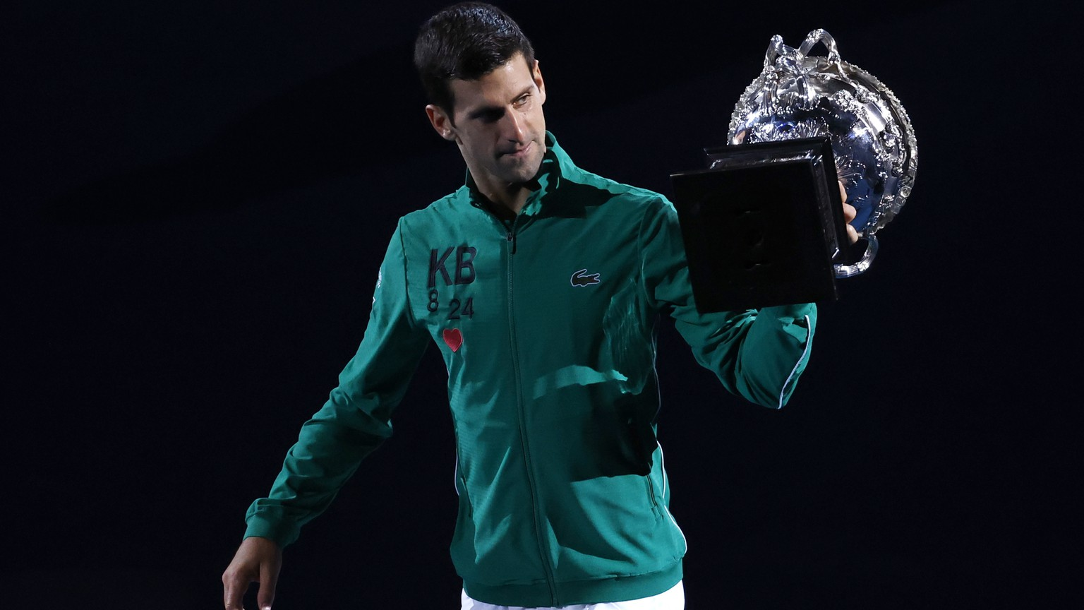 Serbia's Novak Djokovic carries the Norman Brookes Challenge Cup around Rod Laver Arena after defeating Austria's Dominic Thiem in the men's singles final of the Australian Open tennis championship in Melbourne, Australia, early Monday, Feb. 3, 2020. (AP Photo/Dita Alangkara) Novak Djokovic