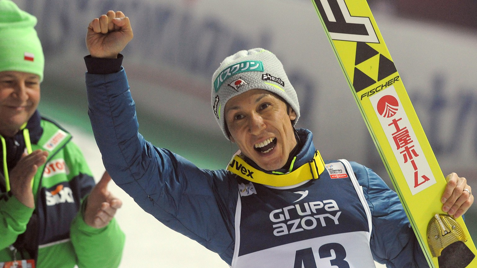 Japan's Noriaki Kasai celebrates his third place in the 34th World Cup Ski Jumping competition, in Wisla, Poland, Friday, March 4, 2016. (AP Photo/Alik Keplicz)