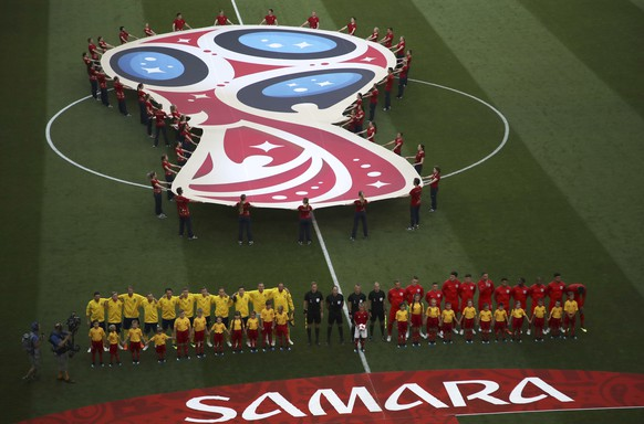 The teams of Sweden, left, and England stand for the national anthems before the quarterfinal match between Sweden and England at the 2018 soccer World Cup in the Samara Arena, in Samara, Russia, Saturday, July 7, 2018. (AP Photo/Thanassis Stavrakis)