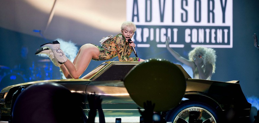 Pop singer Miley Cyrus kicks off her Bangerz tour at Roger's Arena in Vancouver, British Columbia on Friday, Feb. 14, 2014. (AP Photo/The Canadian Press, Jimmy Jeong)