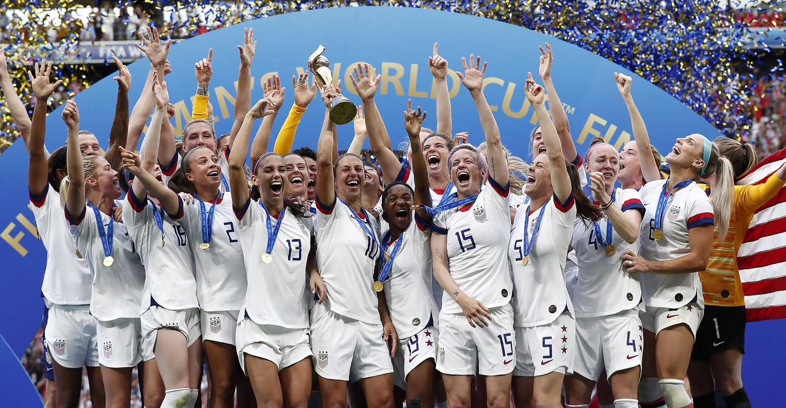 epa07701905 The USA team celebrate after winning the FIFA Women's World Cup 2019 final soccer match between USA and Netherlands in Lyon, France, 07 July 2019.  EPA/IAN LANGSDON
