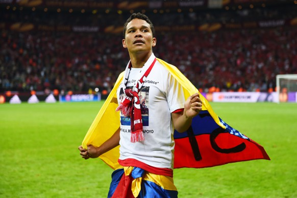 WARSAW, POLAND - MAY 27:  Carlos Bacca of Sevilla celebrates victory after the UEFA Europa League Final match between FC Dnipro Dnipropetrovsk and FC Sevilla on May 27, 2015 in Warsaw, Poland.  (Photo by Shaun Botterill/Getty Images)