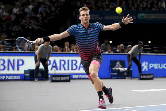 Tomas Berdych of the Czech Republic returns the ball to Novak Djokovic of Serbia in their men's singles quarter-final tennis match at the Paris Masters tennis tournament at the Bercy sports hall in Paris, France, November 6, 2015. REUTERS/Charles Platiau