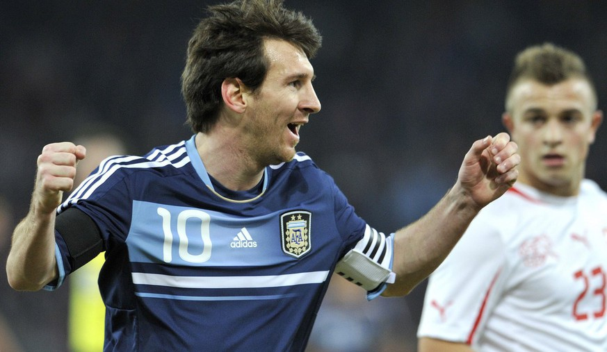 Argentina's Captain Lionel Messi, left, celebrates after scoring a goal next to Switzerland's Xherdan Shaqiri, right, during a friendly soccer match between Switzerland and Argentina at the Stade de Suisse stadium in Bern, Switzerland, Wednesday, February 29, 2012. (KEYSTONE/Peter Schneider)