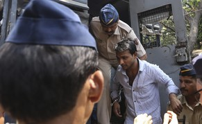 epa04133036 Siraj Khan (C) one of the accused of the gang rape of a 23 year-old Indian photo journalist at a deserted textile mill, is escorted by Mumbai Police as he is taken to Arthur Road Jail after the court hearing in Mumbai, India, 20 March 2014. A court in India's western city of Mumbai found four men guilty of the gang rape of a photo journalist in the city last year after the 23-year-old woman was attacked while on assignment at a deserted textile in August. Sentencing was expected on 21 March, Maharashtra Home Minister RR Patil, who attended the court hearing, told reporters.  EPA/DIVYAKANT SOLANKI