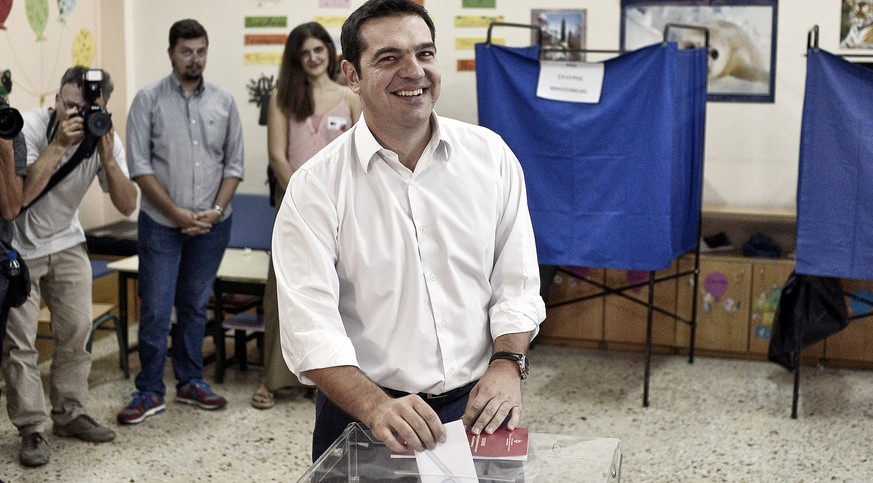 ATHENS, GREECE - SEPTEMBER 20:   The leader of Greece's left-wing Syriza party Alexis Tsipras casts his ballot at a polling station on September 20, 2015 in Athens, Greece. The latest polls have the incumbent Syriza party with a slight lead over the New Democracy. A new bailout of $96 million was approved for Greece in August.  (Photo by Milos Bicanski/Getty Images)