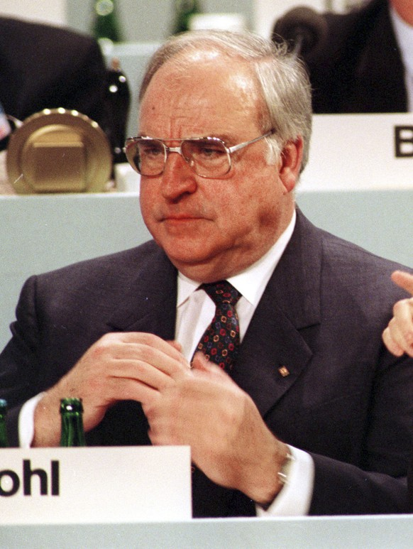 FILE - This undated file photo shows then German Women and Youth Minister Angela Merkel, right, beside then Chancellor Helmut Kohl. Merkel is favored to win a fourth term in Germany's Sept. 24, 2017 election. (AP Photo)