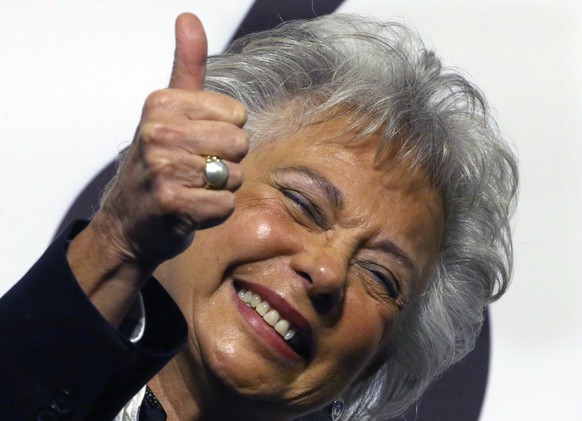 "In this Dec. 14, 2017 photo, Olga Sanchez Cordero gives a thumbs up during a ceremony at which presidential candidate Andres Manuel Lopez Obrador announced his cabinet members, naming her interior secretary, in Mexico City. Sanchez Cordero says the president-elect has given her ""a blank check"" to seek ways to pacify the violence-wracked country. (AP Photo/Marco Ugarte)"