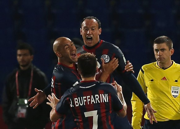 Mauro Matos (C) of San Lorenzo celebrates with his teammates after scoring a goal against Auckland City during their Club World Cup semi-final soccer match at Marrakech stadium December 17, 2014. REUTERS/Youssef Boudlal (MOROCCO - Tags: SPORT SOCCER)