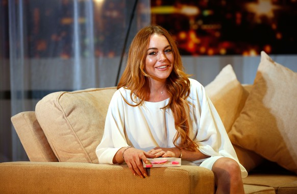 LONDON, ENGLAND - SEPTEMBER 30:  Lindsay Lohan attends a photocall for