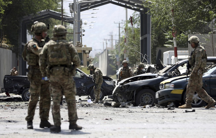 Resolute Support (RS) forces arrive at the site of a car bomb explosion in Kabul, Afghanistan, Thursday, Sept. 5, 2019. A car bomb rocked the Afghan capital on Thursday and smoke rose from a part of eastern Kabul near a neighborhood housing the U.S. Embassy, the NATO Resolute Support mission and other diplomatic missions. (AP Photo/Rahmat Gul)