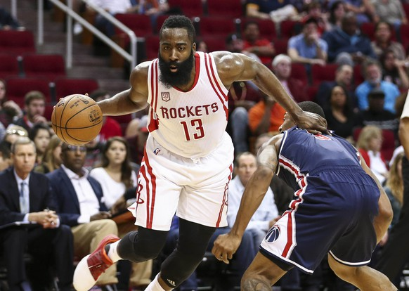 Jan 2, 2017; Houston, TX, USA; Houston Rockets guard James Harden (13) drives to the basket as Washington Wizards guard Bradley Beal (3) defends during the first quarter at Toyota Center. Mandatory Credit: Troy Taormina-USA TODAY Sports