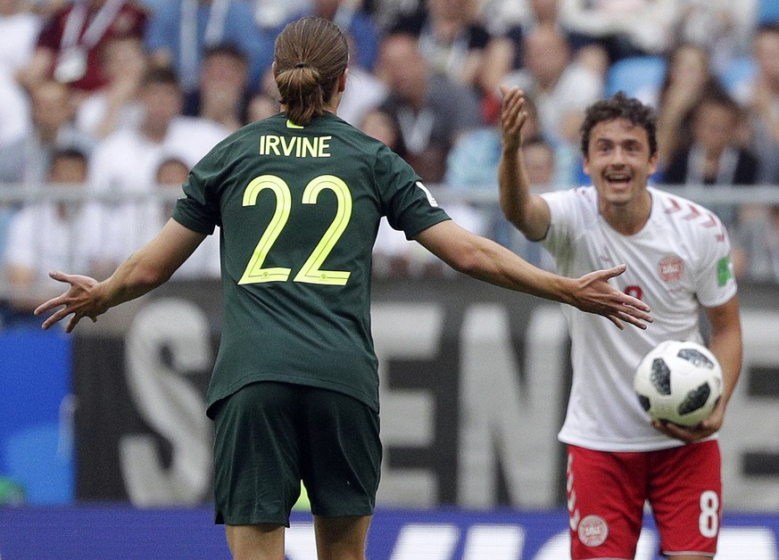 Australia's Jackson Irvine, left, and Denmark's Thomas Delaney gesture during the group C match between Denmark and Australia at the 2018 soccer World Cup in the Samara Arena in Samara, Russia, Thursday, June 21, 2018. (AP Photo/Gregorio Borgia)