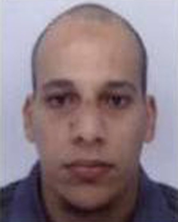epa04550285 An undated handout picture released by French Police in Paris early 08 January 2015 shows Cherif Kouachi, 32, a suspect in connection with the shooting attack at the satirical French magazine Charlie Hebdo headquarters in Paris, France, on 07 January 2015. French police on 08 January 2015 released an appeal to the public for information, with photos of Cherif Kouachi and his brother, Said Kouachi.  EPA/FRENCH POLICE / HANDOUT MANDATORY CREDIT HANDOUT EDITORIAL USE ONLY/NO SALES