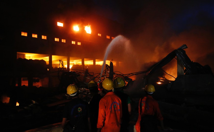 Firefighters work to put out a fire at a packaging factory in Tongi industrial area outside Dhaka, Bangladesh, Saturday, Sept. 10, 2016. A boiler exploded and triggered a fire at a packaging factory near Bangladesh's capital. (AP Photo/A. M. Ahad)