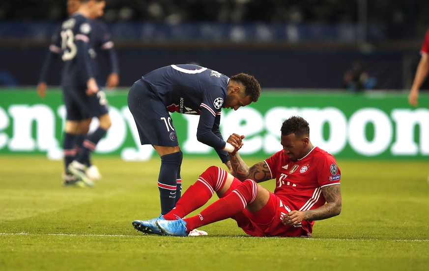 PSG's Neymar and Bayern's Jerome Boateng during the Champions League, second leg, quarterfinal soccer match between Paris Saint Germain and Bayern Munich at the Parc des Princes stadium, in Paris, France, Tuesday, April 13, 2021. (AP Photo/Francois Mori)