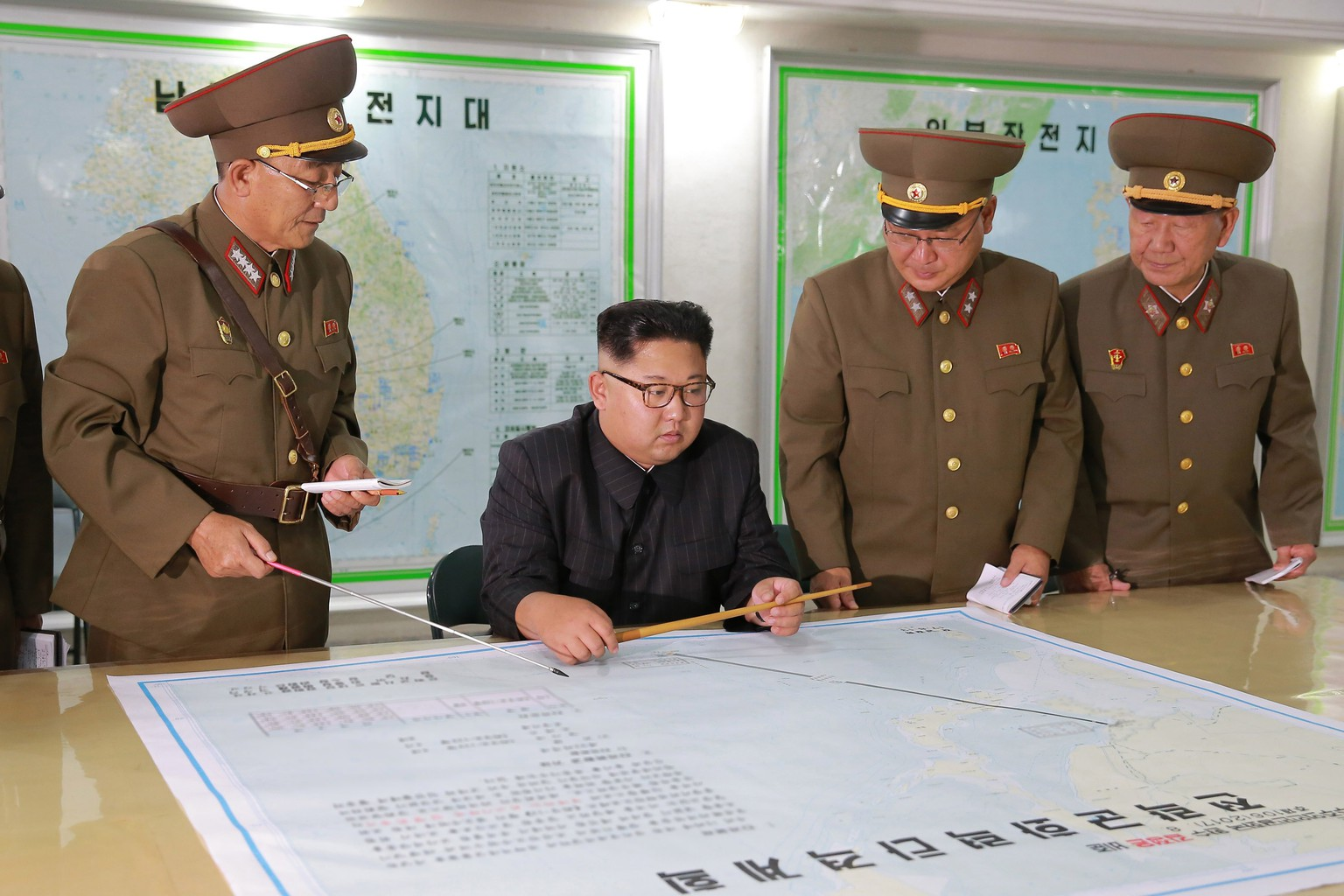 epa06145192 A picture released by the North Korean Central News Agency (KCNA) North Korean leader Kim Jong Un inspecting plans to fire missiles towards the US Pacific territory of Guam at the Command of the Strategic Force of the Korean People's Army (KPA), Pyongyang, DPRK: North Korean 14 August 2017, (issued 15 August 2017). According to North Korean state media on 09 August 2017, the North is considering a potential pre-emptive strike with medium-to-long-range strategic ballistic missiles on Guam, where US tactical bombers are based. The threat follows US President Donald J. Trump's warning to Pyongyang that any threat to the USA 'will be met with fire and fury like the world has never seen.' The exchanges marked rising tensions between the two countries.  EPA/KCNA