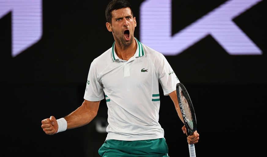 epa09020711 Novak Djokovic of Serbia reacts during his Men's singles semifinals match against Aslan Karatsev of Russia on Day 11 of the Australian Open at Melbourne Park in Melbourne, 18 February 2021.  EPA/DEAN LEWINS AUSTRALIA AND NEW ZEALAND OUT