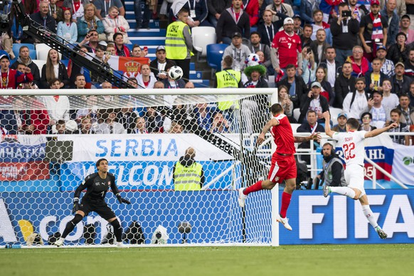 Serbia's forward Aleksandar Mitrovic, center, scores the first goal, against Switzerland's goalkeeper Yann Sommer, left, and Switzerland's defender Fabian Schaer, right, during the FIFA World Cup 2018 group E preliminary round soccer match between Switzerland and Serbia at the Arena Baltika Stadium, in Kaliningrad, Russia, Friday, June 22, 2018. (KEYSTONE/Laurent Gillieron)