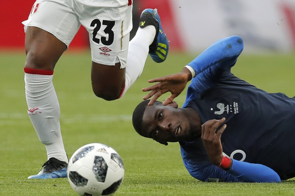 France's Paul Pogbais tackled by Peru's Pedro Aquino during the group C match between France and Peru at the 2018 soccer World Cup in the Yekaterinburg Arena in Yekaterinburg, Russia, Thursday, June 21, 2018. (AP Photo/Vadim Ghirda)