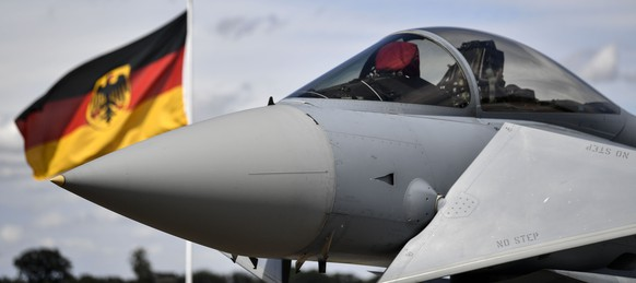 A German Eurofighter jet is pictured at the airbase in Noervenich, Germany, Thursday, Aug. 20, 2020. Pilots from Israel and Germany will fly together the next two weeks during the first joint military Air Force exercises between the two nations in Germany. (AP Photo/Martin Meissner)