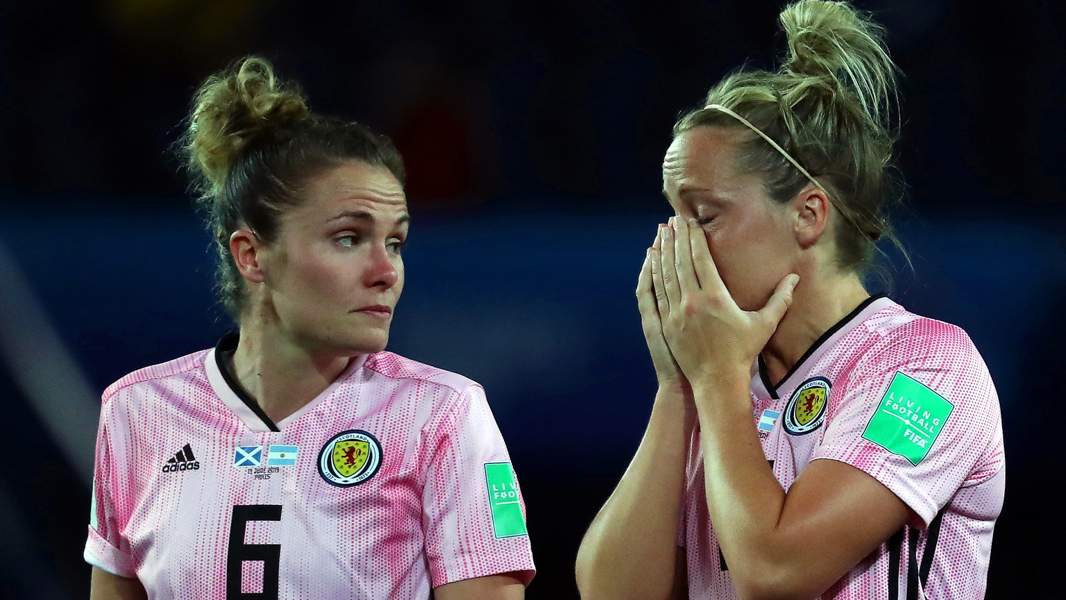 epa07658938 Scotland players Jo Love (L) and Joelle Murray (R) react after the FIFA Women's World Cup 2019 group D soccer match between Scotland and Argentina in Paris, France, 19 June 2019.  EPA/SRDJAN SUKI