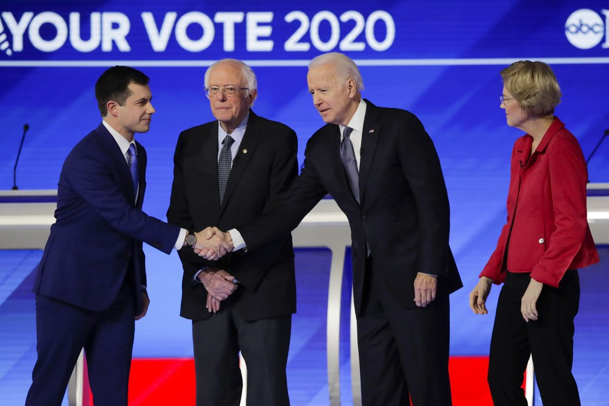 From left, Democratic presidential candidates former South Bend Mayor Pete Buttigieg, Sen. Bernie Sanders, I-Vt., former Vice President Joe Biden, and Sen. Elizabeth Warren, D-Mass., on stage Friday, Feb. 7, 2020, before the start of a Democratic presidential primary debate hosted by ABC News, Apple News, and WMUR-TV at Saint Anselm College in Manchester, N.H. (AP Photo/Charles Krupa) Andrew Yang,Pete Buttigieg,Bernie Sanders,Joe Biden,Elizabeth Warren,Amy Klobuchar,Tom Steyer