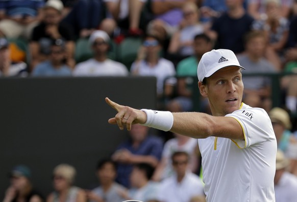 Czech Republic's Tomas Berdych gestures as he plays Austria's Dominic Thiem during their Men's Singles Match on day seven at the Wimbledon Tennis Championships in London Monday, July 10, 2017. (AP Photo/Alastair Grant)