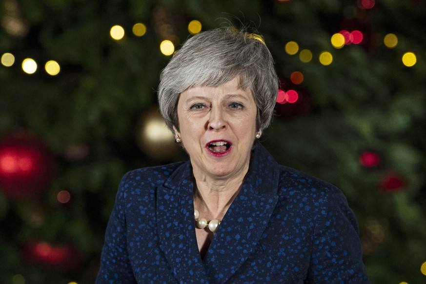 epa07227106 British Prime Minister Theresa May gives a statement outside 10 Downing Street after a Confidence Vote in London, Britain, 12 December 2018. Theresa May won a challenge to her leadership on 12 December 2018 after Conservative Members of Parliament voted in her favour in a Confidence Vote.  EPA/WILL OLIVER
