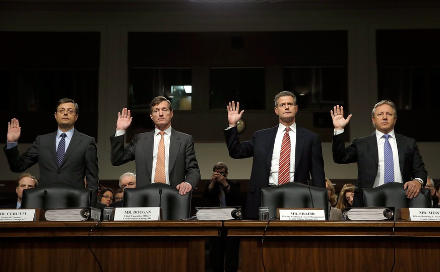 WASHINGTON, DC - FEBRUARY 26:  (L-R) Romeo Cerutti, general counsel of Credit Suisse; Brady Dougan, CEO of Credit Suisse Group; Robert Shafir, co-head of Swiss Private Banking and Wealth Management and Hans-Ulrich Meister, co-head of Swiss Private Banking and Wealth Management are sworn in before the Senate Homeland Security and Governmental Affairs Committee February 26, 2014 in Washington, DC. The committee is listening to testimony on