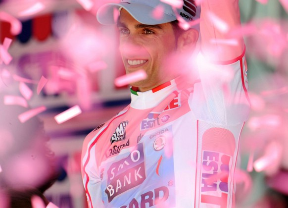 Spain's Alberto Contador celebrates on the podium after winning the 94th edition of the Giro d'Italia, Tour of Italy cycling race, in Milan, Sunday, May 29, 2011. Contador secured his second Giro d'Italia title with a comfortable third-place finish in the final stage, beating his closest rival for the pink jersey by more than six minutes. (AP Photo/Giovanni Auletta)