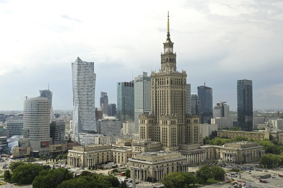 In this May 25, 2018 photo, the communist era Palace of Culture and Science, foreground, is one of the many skycrapers in the city skyline, in Warsaw, Poland. Warsaw, a city of Old World charm that was turned to rubble and ash by Nazi Germany, has been reborn twice. The Polish capital first became an example of socialist city planning, rising in the postwar era as a drab and grey embodiment of oppressive Communist rule. But almost three decades of post-communist economic growth have produced a booming city of modern glass architecture, cutting-edge museums and revitalized historic buildings.  (AP Photo/Alik Keplicz)