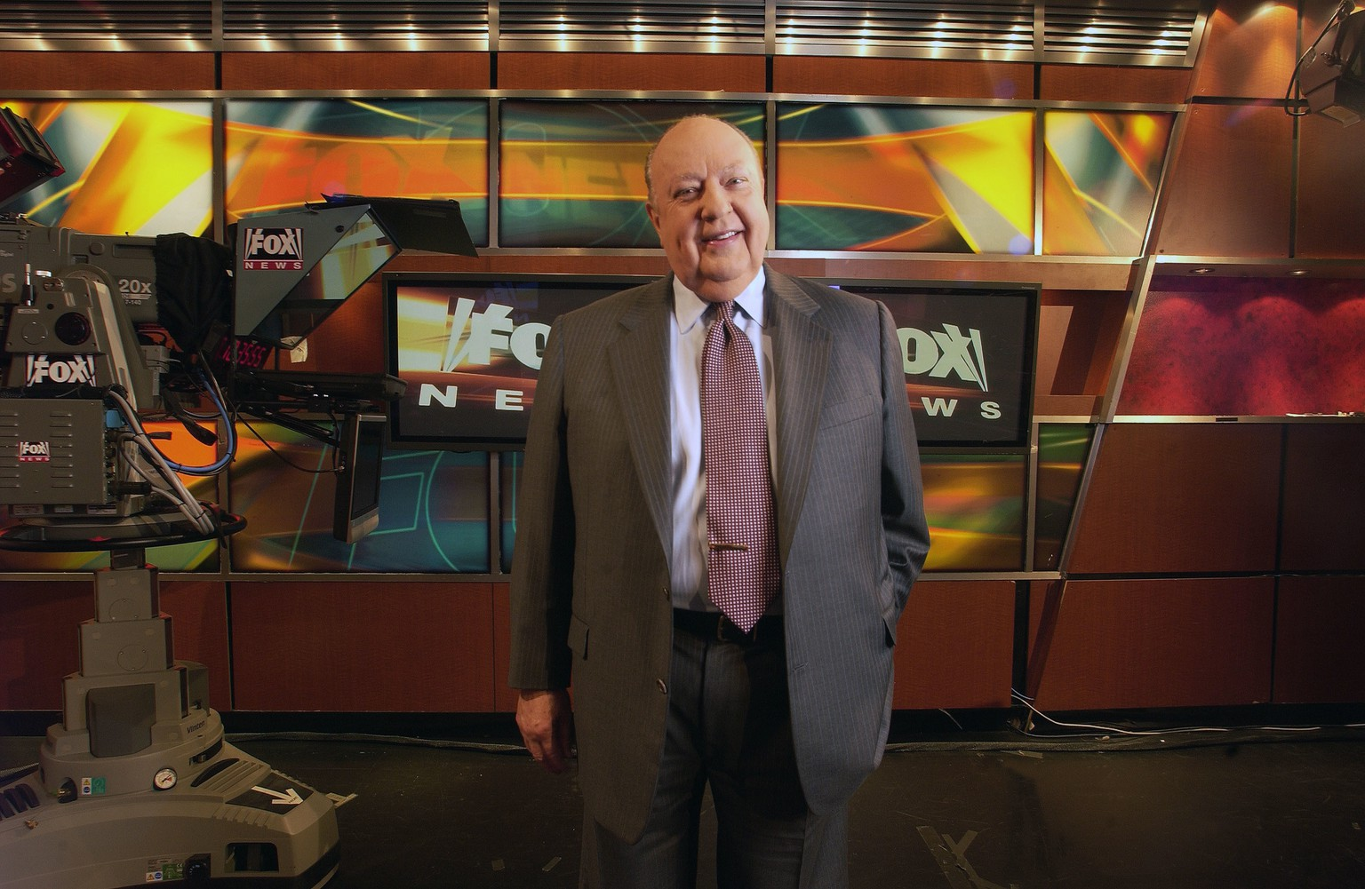 FILE - In this Sept. 29, 2006 file photo, Fox News CEO Roger Ailes poses at Fox News studio in New York. At age 76, Ailes has been vanquished from Fox News Channel, which he masterminded almost 20 years ago and had lorded over ever since. Little more than two weeks ago, a lawsuit filed by former Fox News host Gretchen Carlson charged him with sexual harassment. He denied her allegations, and those from other past and present female co-workers who spoke up after her. But with blistering speed his reign ended Thursday, July 21, 2016. (AP Photo/Jim Cooper, File)