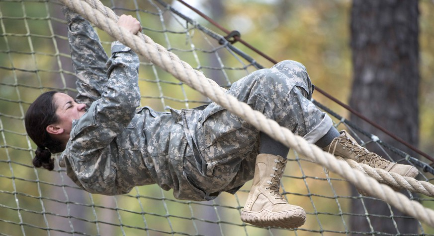 This undated photo released by the Utah National Guard, shows 1st. Lt. Alessandra Kirby negotiating the Darby Obstacle Course at Fort Benning during the Ranger Assessment. Kirby, a Utah National Guard solider will be among a handful of women going to the grueling Army Ranger school as part of the U.S. military's first steps toward allowing women to move into the elite combat unit. (AP Photo/US Army, Patrick A. Albright)