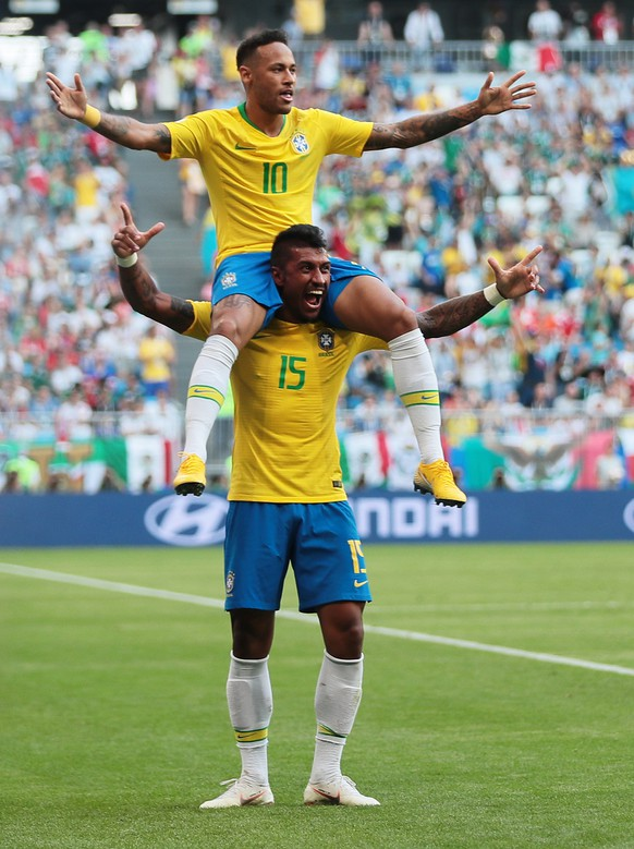 epa06858258 Neymar (top) of Brazil celebrates with teammate Paulinho after scoring the 1-0 during the FIFA World Cup 2018 round of 16 soccer match between Brazil and Mexico in Samara, Russia, 02 July 2018.  (RESTRICTIONS APPLY: Editorial Use Only, not used in association with any commercial entity - Images must not be used in any form of alert service or push service of any kind including via mobile alert services, downloads to mobile devices or MMS messaging - Images must appear as still images and must not emulate match action video footage - No alteration is made to, and no text or image is superimposed over, any published image which: (a) intentionally obscures or removes a sponsor identification image; or (b) adds or overlays the commercial identification of any third party which is not officially associated with the FIFA World Cup)  EPA/WALLACE WOON   EDITORIAL USE ONLY