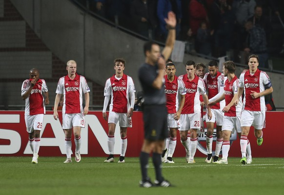 Ajax players leave the field of play as referee Carlos Velasco Carballo, center, whistles the end of the first half time during the Group F Champions League match between Ajax and Apoel at ArenA stadium in Amsterdam, Netherlands, Wednesday, Dec. 10, 2014. (AP Photo/Peter Dejong)