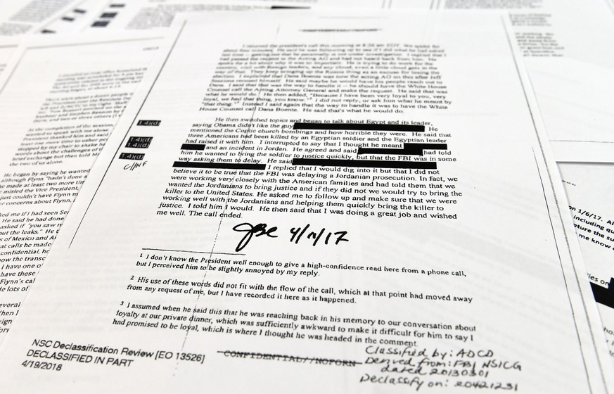 Copies of the memos written by former FBI Director James Comey are photographed in Washington, Thursday, April 19, 2018. President Donald Trump told former FBI Director James Comey that he had serious concerns about the judgment of his first national security adviser, Michael Flynn, according to memos maintained by Comey and obtained by The Associated Press. The 15 pages of documents contain new details about a series of interactions that Comey had with Trump in the weeks before his May 2017 firing. Those encounters include a White House dinner at which Comey says Trump asked him for his loyalty. (AP Photo/Susan Walsh)