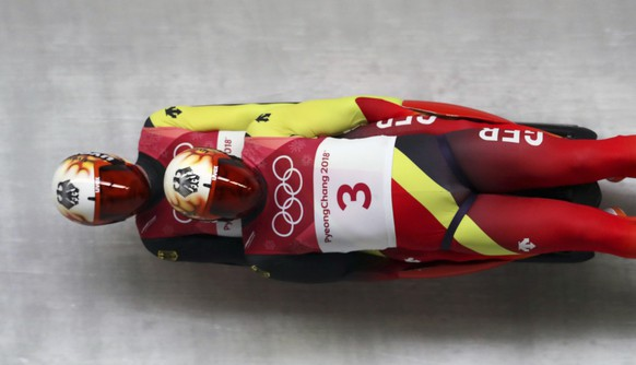Tobias Arlt and Tobias Wendl of Germany takes a curve during the men's doubles luge final at the 2018 Winter Olympics in Pyeongchang, South Korea, Wednesday, Feb. 14, 2018. (AP Photo/Michael Sohn)
